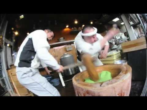 Short video, but quite insane. Super coordinated Japanese mochi makers.