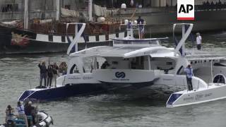 (15 Jul 2017) A boat that fuels itself is setting off around the world from Paris on a six-year journey that its designers hope will serve as a model for emissions-free energy networks of the future.Energy Observer will use its solar panels, wind turbines and a hydrogen fuel cell system to power its trip.The five million-euro (5.25 million US dollars) boat heads off on Saturday from Paris toward the Atlantic.The futuristic-looking 30.5-metre (100-foot) boat will rely on sun or wind during the day and tap into its hydrogen reservoirs at night.It produces its own hydrogen through electrolysis of sea water.Originally designed in 1983, the boat enjoyed a successful career in open-sea sailing races before skippers Frederic Dahirel and Victorien Erussard and a French research institute converted it into the Energy Observer project.You can license this story through AP Archive: http://www.aparchive.com/metadata/youtube/a7eae23b2a7913d4efadb2962b8c4d9a Find out more about AP Archive: http://www.aparchive.com/HowWeWork