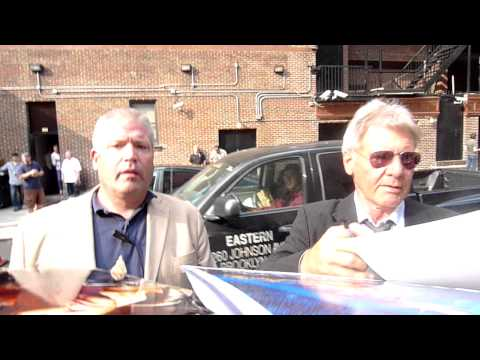Harrison Ford promoting Cowboys & Aliens signing autographs at Letterman