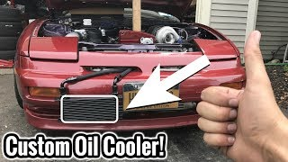 STICKERShttps://www.kalvinsgarage.bigcartel.comToday we tackle the oil cooler install on the 240sx. Its something I've wanted to install for a while now. Glad its on there. See you all tomorrow for the final button up!-10an 90 Degree Fittings: http://amzn.to/2v9wsUBDerale Oil Cooler: http://amzn.to/2sMr9d2-10an Braided Hose: http://amzn.to/2tF8W3POil Sandwich plate: http://amzn.to/2sN9LF0FOLLOW ME!!Instagram: @Kalvin_MalliFaceBook: https://www.facebook.com/thatburgundy240/SnapChat: ThatBurgundy240Twitter: https://twitter.com/ThatBurgundy240Want my camera?http://amzn.to/2qVqNih  ( Buy here )Aftermarket Parts Marketplace FREE: https://www.throtl.com/i/KM240Mobile App Available on iOS & Android PROMO CODE: KM240PO BOX: 412Fishers NY 14453-0412