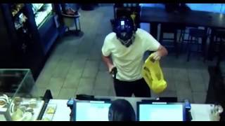 Heroic Starbucks customer smashes armed robber with chair then restrains him.
