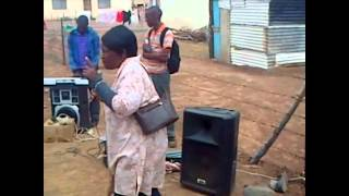 Lady Preaching in the community about the rich man, Abraham and Lazarus.