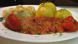 Рыба запеченая с томатами в собственном соку  рецепт