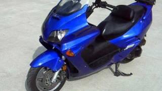 5. 2006 HONDA 250 REFLEX SCOOTER $1900 WWW.RACERSEDGE411.COM RACERS EDGE