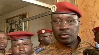 Burkina Faso's military has been given two weeks to hand over power to a civilian leader or face sanctions from the African Union.