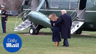 President Trump catches First Lady Melania as she stumbles