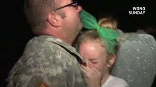 Army dad surprises his daughter at her homecoming dance