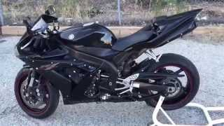 5. 2005 Yamaha R1 Raven Edition (rev on stock exhaust, custom seats, red flush front signals)