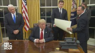 Watch President Trump's first signings in Oval Office