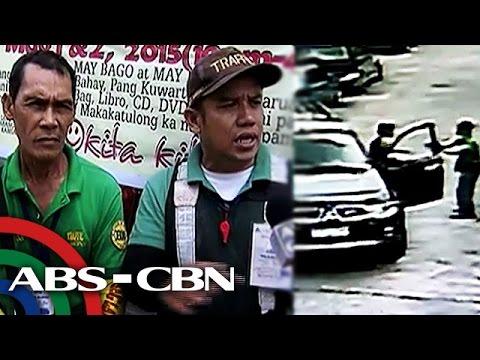 Dalawang traffic enforcer tinutukan ng baril matapos manita