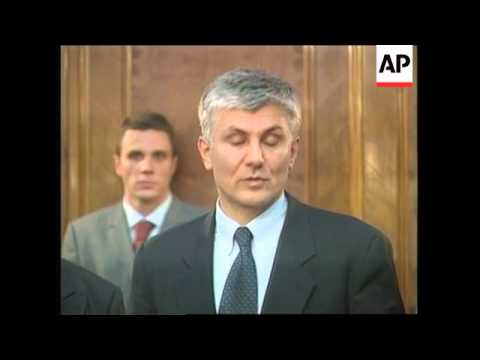 More pictures, Milosevic handed over to war crimes tribunal