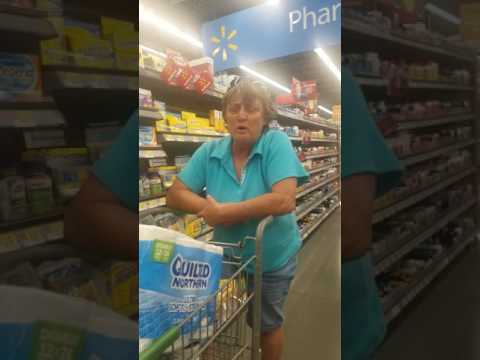 Racist lady berates 2 women in Walmart. Upstanding employee actually steps in and helps out.
