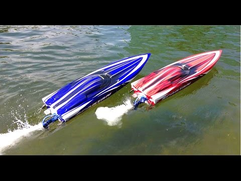 RC ADVENTURES - Duelling Traxxas Spartan Speed Boats and Two DJi Phantoms taking Aerial Footage
