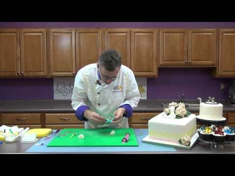 multiple heels and shoes - http://globalsugarart.com In this video Chef Alan Tetreault, of Global Sugar Art, teaches how to cut and assemble high-heeled shoes using JEM's shoe cutter s...