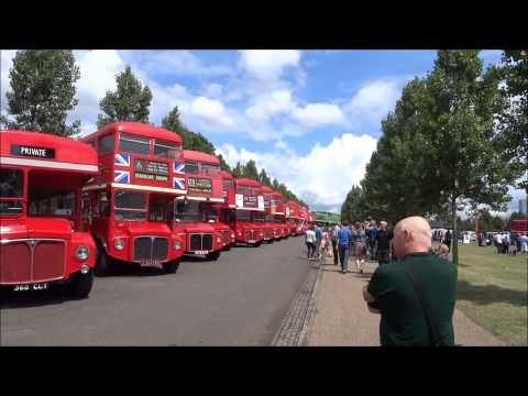 Walking amongst bus enthusiasts looking at lots of Routemaster buses at Finsbury Park, London.