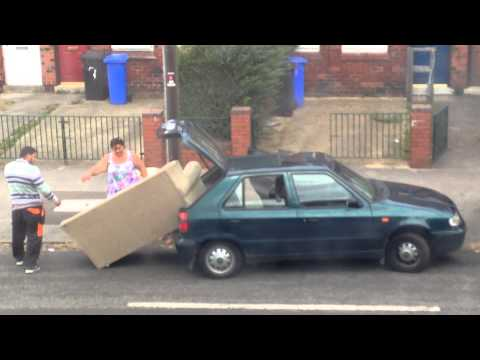 Three Idiots Try to Fit a Big Sofa in a Tiny Car [Video]