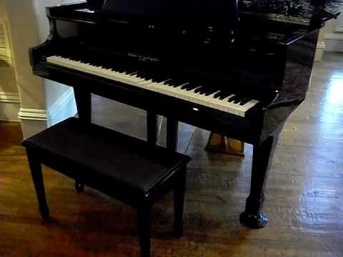 Beautiful Black Baby Grand Piano, Formal Couch, 2 Leather Accent Chairs, Dining Room