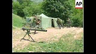 YUGOSLAVIA: KOSOVO: KLA WATCH AS NATO BOMBS SERB POSITIONS