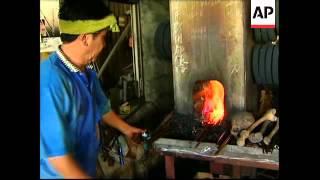 Human bones fuel fire to make swords