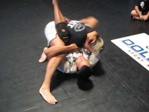 Vinny Magalhaes shows How to Flower Sweep to Triangle Choke