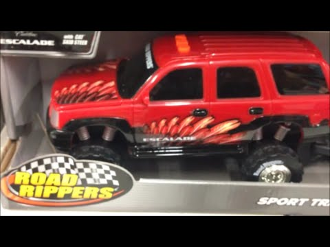 Road Rippers Escalade Towing a Caterpillar Skid Steer Bucket Loader Toy