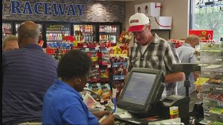 Locals line up for powerball tickets ahead of $758 million jackpot.