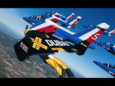 Winged Jetpackers Fly In Formation With Fighter Jet