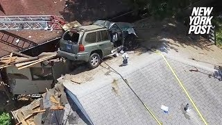 A bizarre car accident occurred in St. Louis when a driver, likely speeding, apparently lost control of his car and hit a sloped lawn, which acted like a ramp and launched his car into the air. He landed on top of a house.