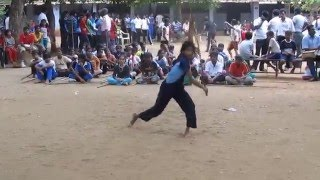 She is from Tamil Nadu state India, performing fast movements with stick. She is performing this in her school competition.
