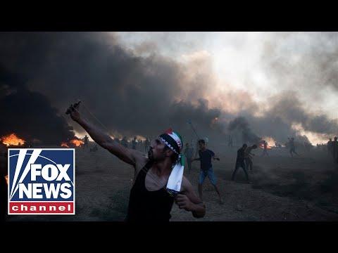 Tens of thousands protesting at Israeli-Gaza border