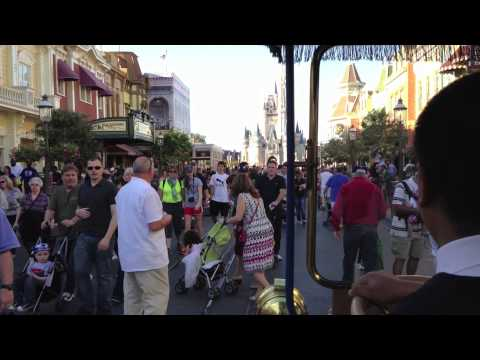 Main Street USA - Come with us as we hitch a ride on the Main Street Transportation Company's horseless carriage. We're riding from Town Square, down a busy Main Street USA, t...