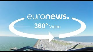 In this 360° video, discover the Afsluitdijk - a giant dyke that's part of the Netherlands' efforts to protect its population from flooding.What are the top stories today? Click to watch: https://www.youtube.com/playlist?list=PLSyY1udCyYqBeDOz400FlseNGNqReKkFdeuronews: the most watched news channel in EuropeSubscribe! http://www.youtube.com/subscription_center?add_user=euronews euronews is available in 13 languages: https://www.youtube.com/user/euronewsnetwork/channelsIn English:Website: http://www.euronews.com/newsFacebook: https://www.facebook.com/euronewsTwitter: http://twitter.com/euronewsGoogle+: http://google.com/+euronewsVKontakte: http://vk.com/en.euronews