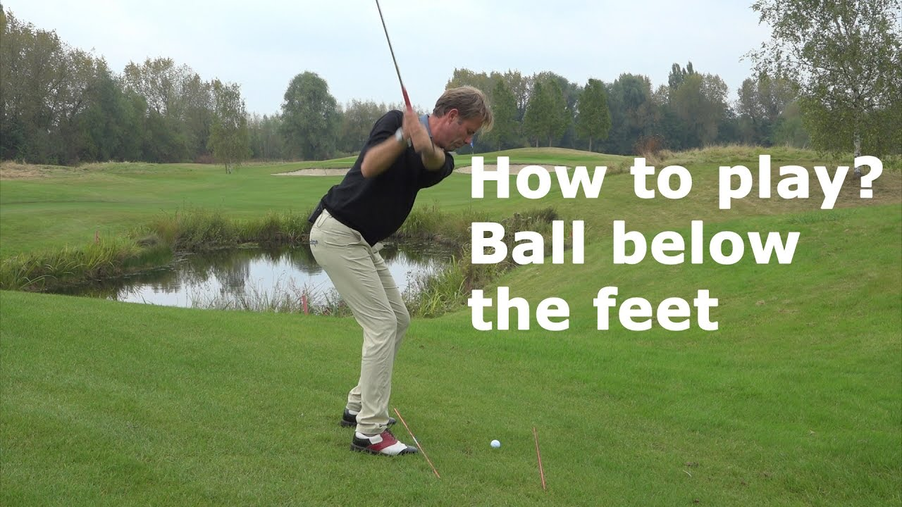 How to play a golfball below the feet?