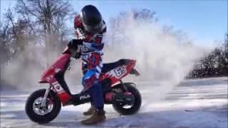 Scooter in winter tyres drift - wheelie