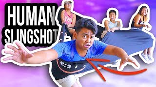 My sibling and I try out the human slingshot!Get your own Guava Juice Box ➽ https://goo.gl/0dTjI7Guava Juice Merchandise ➽ http://www.crowdmade.com/guavajuiceWanna help do my captions?  ➽ http://bit.ly/2pDaiIVSubscribe and become a GUAV! ➽ http://bit.ly/GUAVAJUICESend me some FAN ART! ➽  http://bit.ly/GuavaFBGuava Juice Merchandise ➽ http://www.crowdmade.com/guavajuiceFollow me on the Social Media!----------------------------------------------------------------Twitter ➽ http://www.twitter.com/GuavaRoiInstagram ➽  http://www.instagram.com/GuavaRoiFacebook ➽ http://www.facebook.com/GuavaRoiSnapchat ➽  WhereIsRoiWatch some of these AWESOME playlists!----------------------------------------------------------------Randomness! ➽ - http://bit.ly/GuavaRandomChallenges! ➽ - http://bit.ly/GuavaCHALLENGESRoblox! ➽  - http://bit.ly/GuavaROBLOXTutorials!! ➽ http://bit.ly/GuavaTUTORIALS╘[◉﹃◉]╕ ╘[◉﹃◉]╕╘[◉﹃◉]╕What's up YouTube! Welcome to Guava Juice, You may know me from Wassabi Productions. This is my new gaming channel where I will be putting out all my content going forward. I post two videos a day at 12PM and 3PM PST!On here you'll find lots of ridiculous fun games from Happy Wheels, Roblox and Yandere Simulator to random games you've never heard of! You'll also find INSANE challenges, sketch comedy, and random shenanigans that you'll love! Subscribe and become a GUAV! Be yourself, be humble, and inspire!Thanks for watching doodes! ( ́ ◕◞ε◟◕`)Thanks for reading the end of this description!#stayjuicy #guavajuice