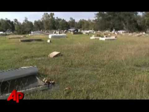 Cemetery - Dozens of volunteers in Orange, Texas are trying to restore a cemetery wiped away by Hurricane Ike. Caskets littered the cemetery following the storm, some e...