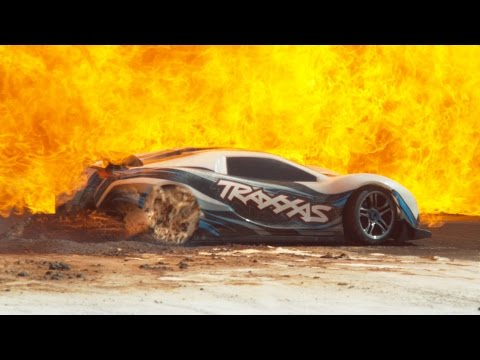 An RC Car Drives 100mph Through Flames Flour and Into a HeadOn Collision in Slow