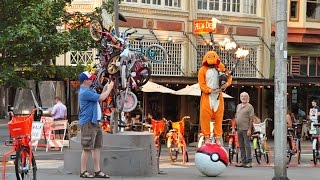 Watch a Man Dressed as Charmander Balancing on a Pokeball Play the Pokemon Theme Song With Flaming Bagpipes