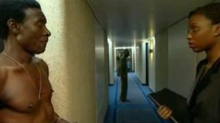 Un film en langue Wolof with English subtitles, produit par Global Dialogues. Dans lascenseur dun hôtel à Dakar, un homme...