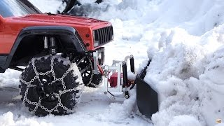 Our SCX10 ii did some RC snow plowing last weekend! The RC snow plow and snow chains from Xtra Speed did the job quite well!Snow Plow- http://bit.ly/snowPlow_forSCX10_XtraSpeed_rcMartSnow chains- http://bit.ly/SteelSnowChain_For-Crawler-tiresThe snow plow is for a regular axial SCX10, but since the SCX10 ii shares the same chassis rails, it mounted right up. This was my first time using an RC snow plow, and let me say I want a larger version so I don't have to shovel anymore haha! The setup worked quite well!This rc snow plow is raised and lowered with a servo on the third channel of a radio.The RC in this video is an Axial SCX10 ii Jeep cherokee XJ 4x4 1/10 scale model. #scx10ii #rctrucks #snow #winter #rc #hobby #scx102 #axial