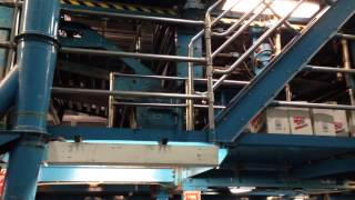 Brief clip of a newspaper printing press. From College Point facility.