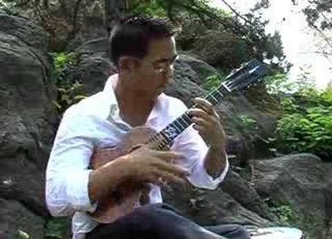 While My Guitar Gently Weeps (2006) (Song) by Jake Shimabukuro