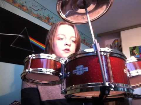 Kid Excited About The New Drum Kit He Got For Christmas
