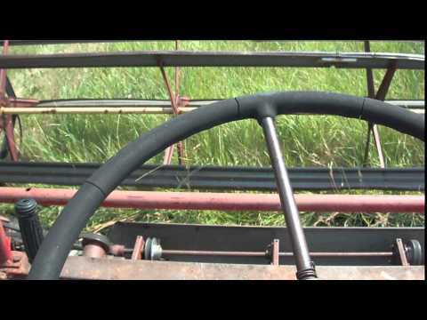 swathing - sitting on the tractor swathing.