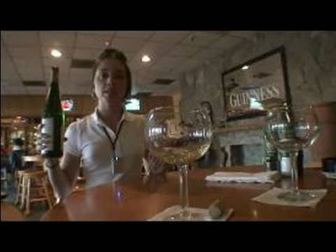 waiter - Learn how to pour wine at the table with expert tips and advice on customer service in this free video clip on waiting tables. Expert: Leslie Moselle Bio: Wi...