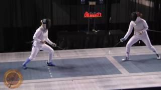 This is a semifinal bout in the women's foil event at the NCAA fencing championships in Indianapolis, Indiana. Alanna Goldie of Ohio State University is on the right and Margaret Lu of Columbia University is on the left.