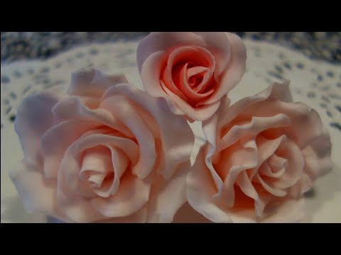 fondant suitcase cake - A short film showing how to make fondant roses for cakes, starting with the rose bud and ending with the complete flower.