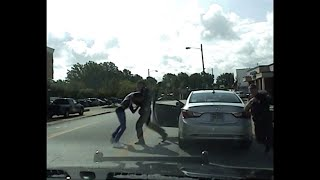 Dash cam video of a traffic stop in Ohio shows a white police officer punching the driver who is black. The video shows the officer wrestling the driver to the ground after he exits the car. (August 18)Subscribe for more Breaking News: http://smarturl.it/AssociatedPress