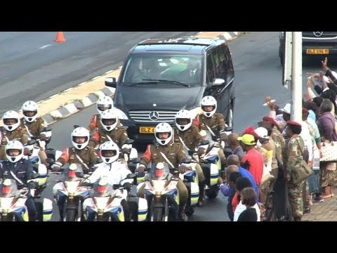 Through - Nelson Mandela's funeral cortege is taken to the seat of the South African government in Pretoria, where his remains will lie in state for three days.Duratio...