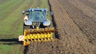 New Holland TM140 with 9 furrow Rumptstad WE-9 ECO-plough / ploeg